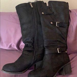 Torrid black knee-high boots with chunky heel.